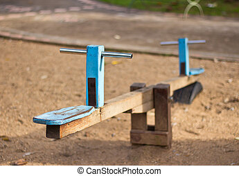 Wooden see-saw - Old wooden see saw at the playground
