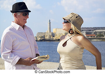 Tourism and active retirement with elderly people traveling, senior couple having fun on holidays in Havana, Cuba