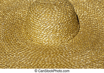 Raffia Sun hat of straw, closeup, backgrounds