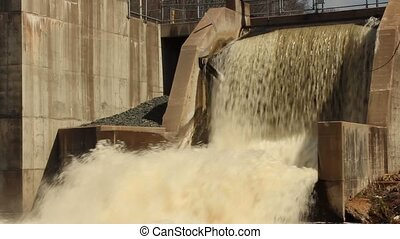 Spring runoff - water flowing through a dam after the Spring...