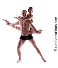 Two young smiling acrobats posing in studio