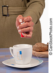 Artificial sweetener - Artificial sweetner being added to a...