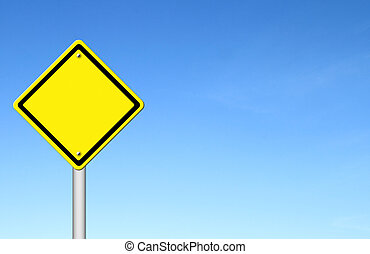 blank yellow traffic sign with blue sky