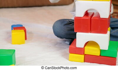 Child playing with blocks - Boy 9 years old building a stack...