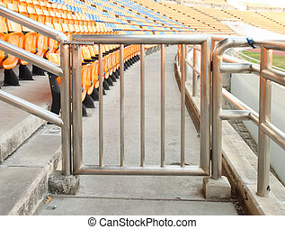 small metal barrier at sports stadium