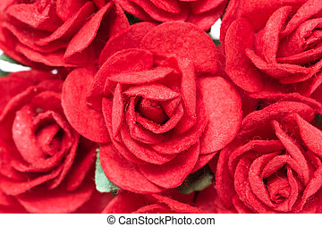 Full frame of artificial red roses