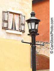 ancient lamppost with vintage window and wall background