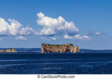Perce Rock in a sunny day in Saint Lawrence river in...