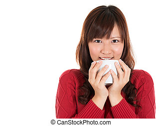 Asian woman drinking coffee or tea - Beautiful mixed Asian...