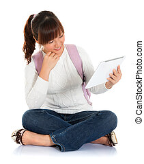 Asian female student using tablet pc