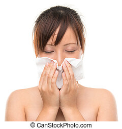 Flu or cold - sneezing woman sick blowing nose. - Young...