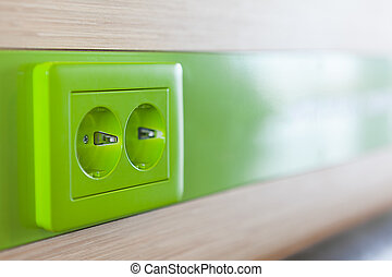 Green appliance receptacle for charging. Close up