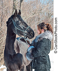 women with black horse. funny shot - women with black horse....