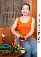 Mature woman with  seedlings