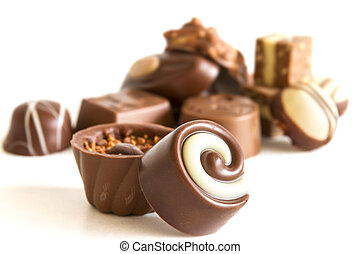 Chocolate candys and truffles on white background