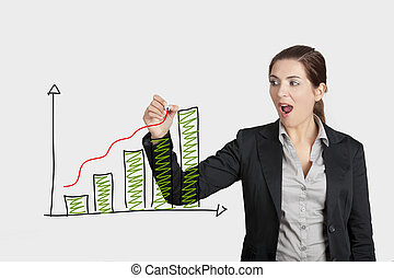 Drawing a chart - Beautiful woman drawing a business chart...