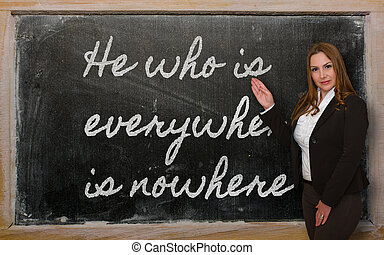 Teacher showing He who is everywhere is nowhere on...