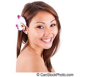 Headshot portrait of a young beautiful asian woman isolated...