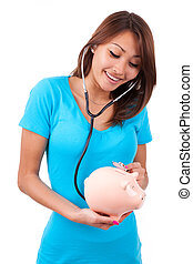 Young happy beautiful asian woman using stethoscope on her...