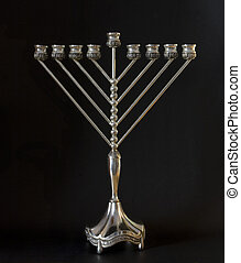Hanukkah menorah - Traditional Hanukkah menorah on a black...
