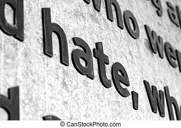 The word HATE carved into stone - A detail shot of the word...