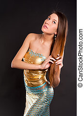 Young pretty mermaid - Young beautiful woman in mermaid...