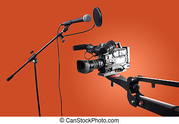 camera and microphone - dv-cam camcorder on crane and studio...