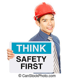 Safety First  - A man holding a sign with a safety message