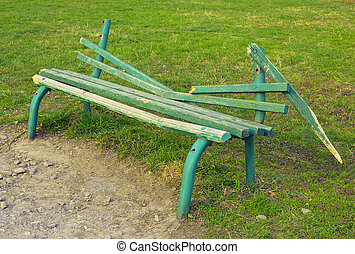 broken green bench in the park