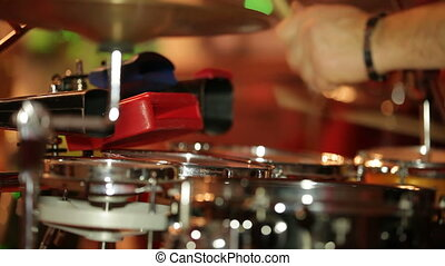 Drum musician playing at a party Close-up