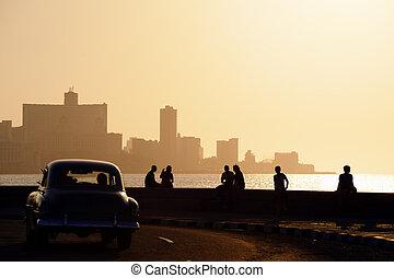 People and skyline of La Habana, Cuba, at sunset