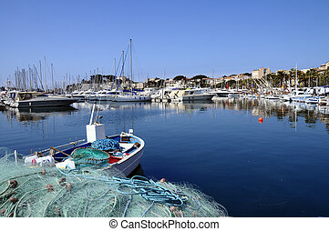 Marina of Bandol in France View of fishing nets, boats and...