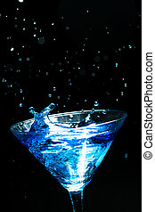 blue splashing cocktail on black