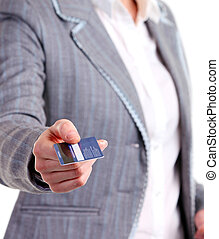 Closeup view of a female holding a plastic card. Image with...