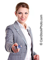 Young smiling business woman stretching out hand with...