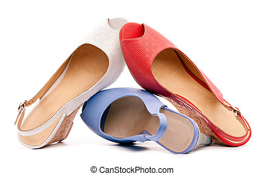 Three open-toe women shoes against white background