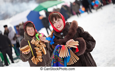 girls celebrating Shrovetide at Russia - Two happy girls...