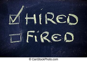 hired vs.fired - chalk writings on blackboard, hired vs....