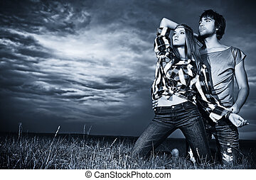 feel storm - Romantic young couple in casual clothes sitting...