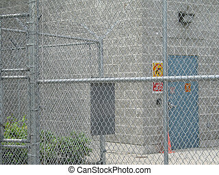 industrial building behind a fence