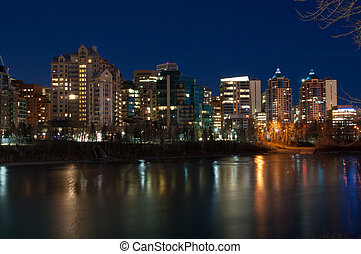 Luxury condos at night along the Bow River in Calgary...