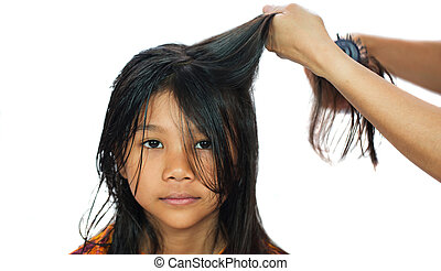 Young Girl Getting Hair Dried - A young Malay Asian girl...