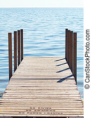 Empty Dock In Broad Daylight - Boat launching dock going out...