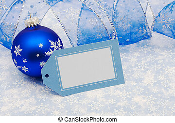 Merry Christmas - Blank gift tag with blue ribbon and glass...