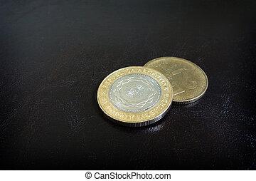 Pesos - Closeup of Argentine peso coins...