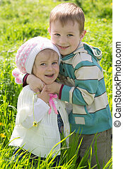 Brother giving hug to sister outdoors
