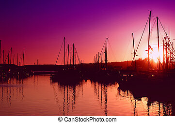 Purple Sunset - Sun setting behind an oceanfront marina
