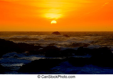 Orange Sunset - Sun setting over the Pacific Ocean near...
