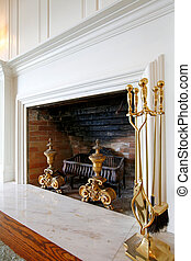 Old wood fireplace with white mental.