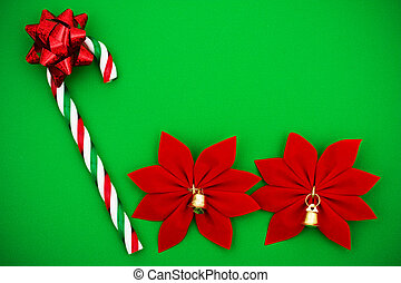 Candy Cane - Candy cane with red bow and poinsettia on green...